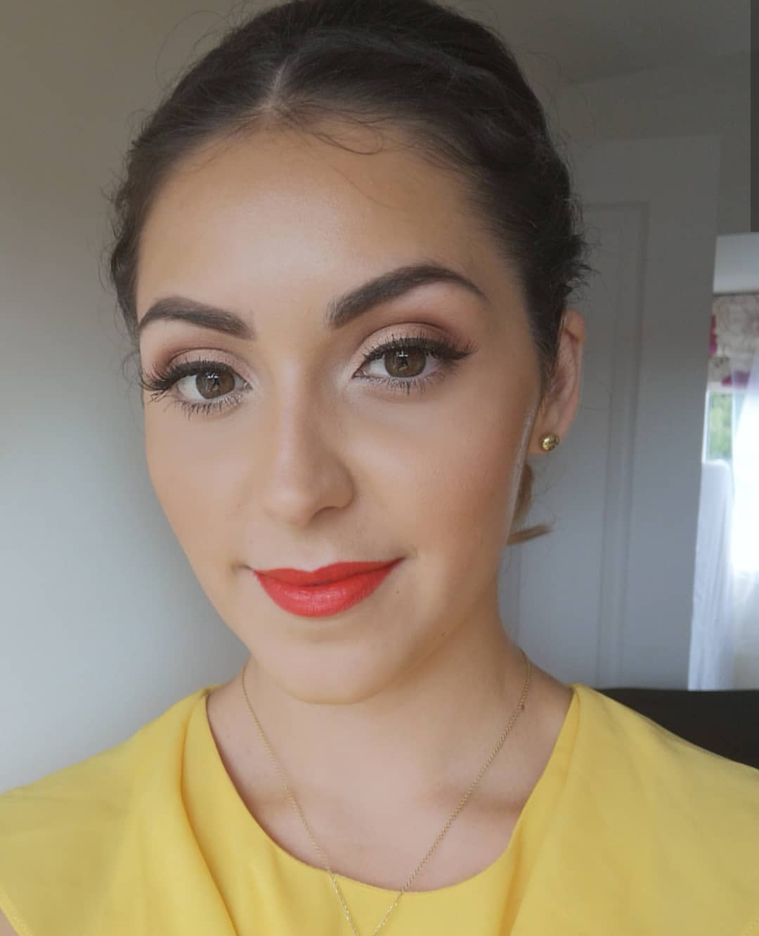 red lip and winged liner
