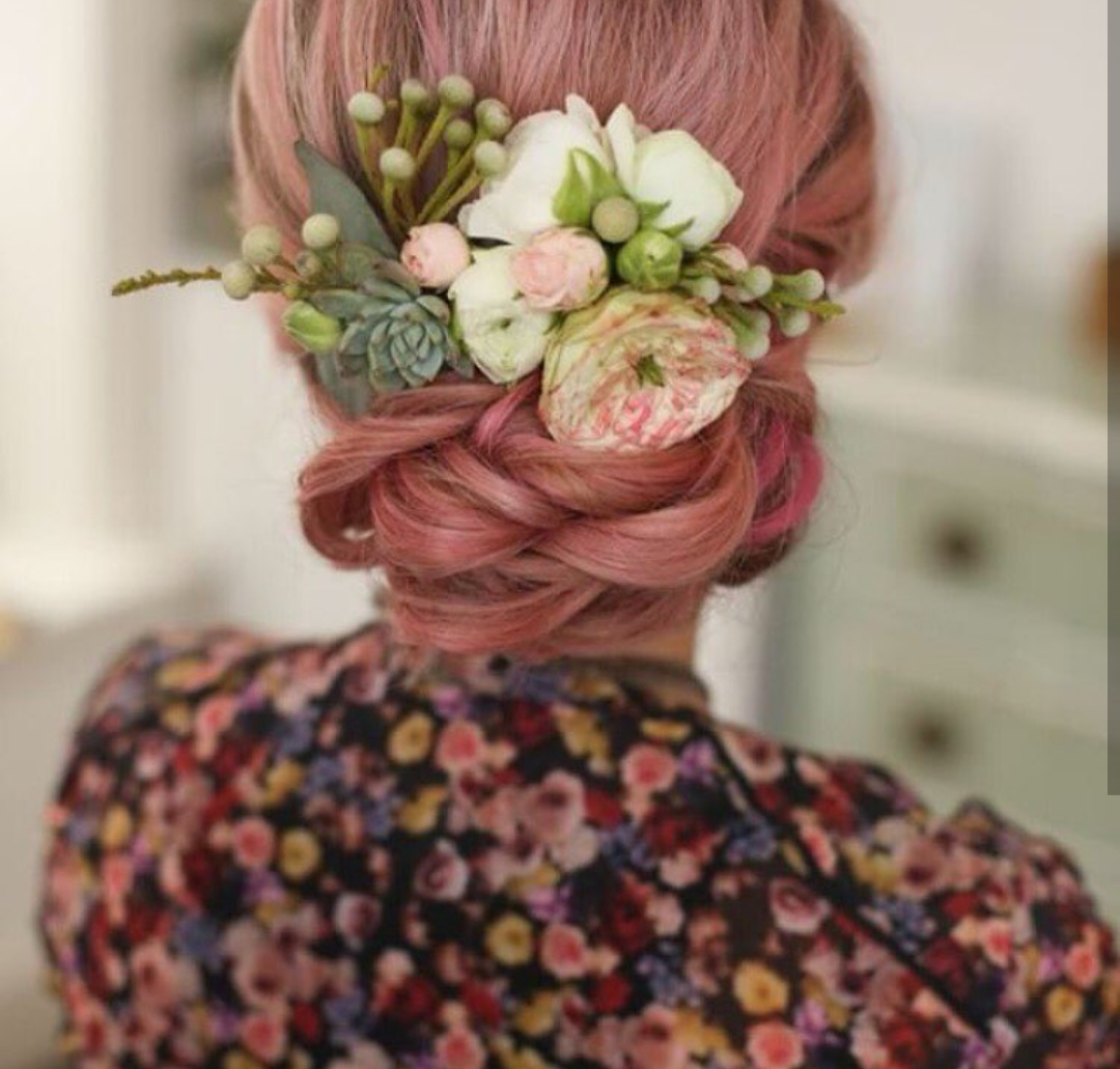Low updo with fresh flowers
