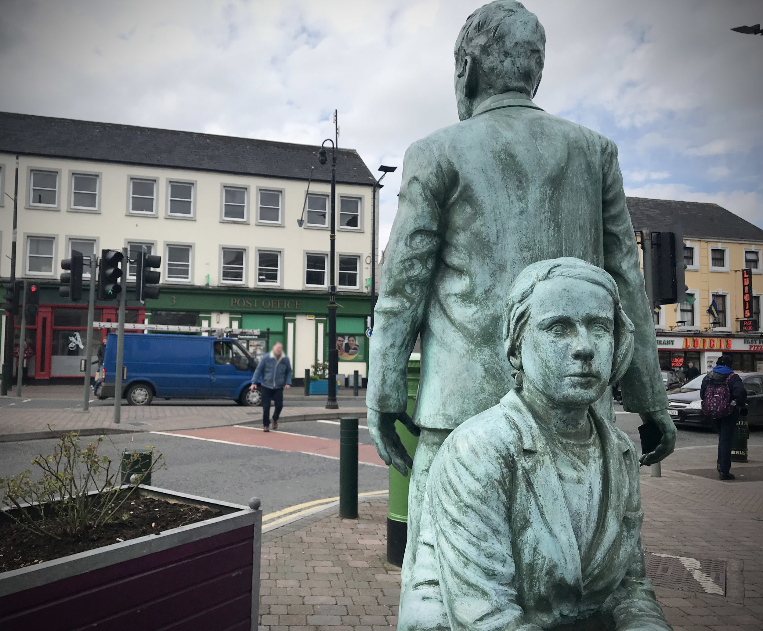 "Emigration statue in Longford. The inscription on the bottom of the statue reads ""All are missed. Always welcome home."""