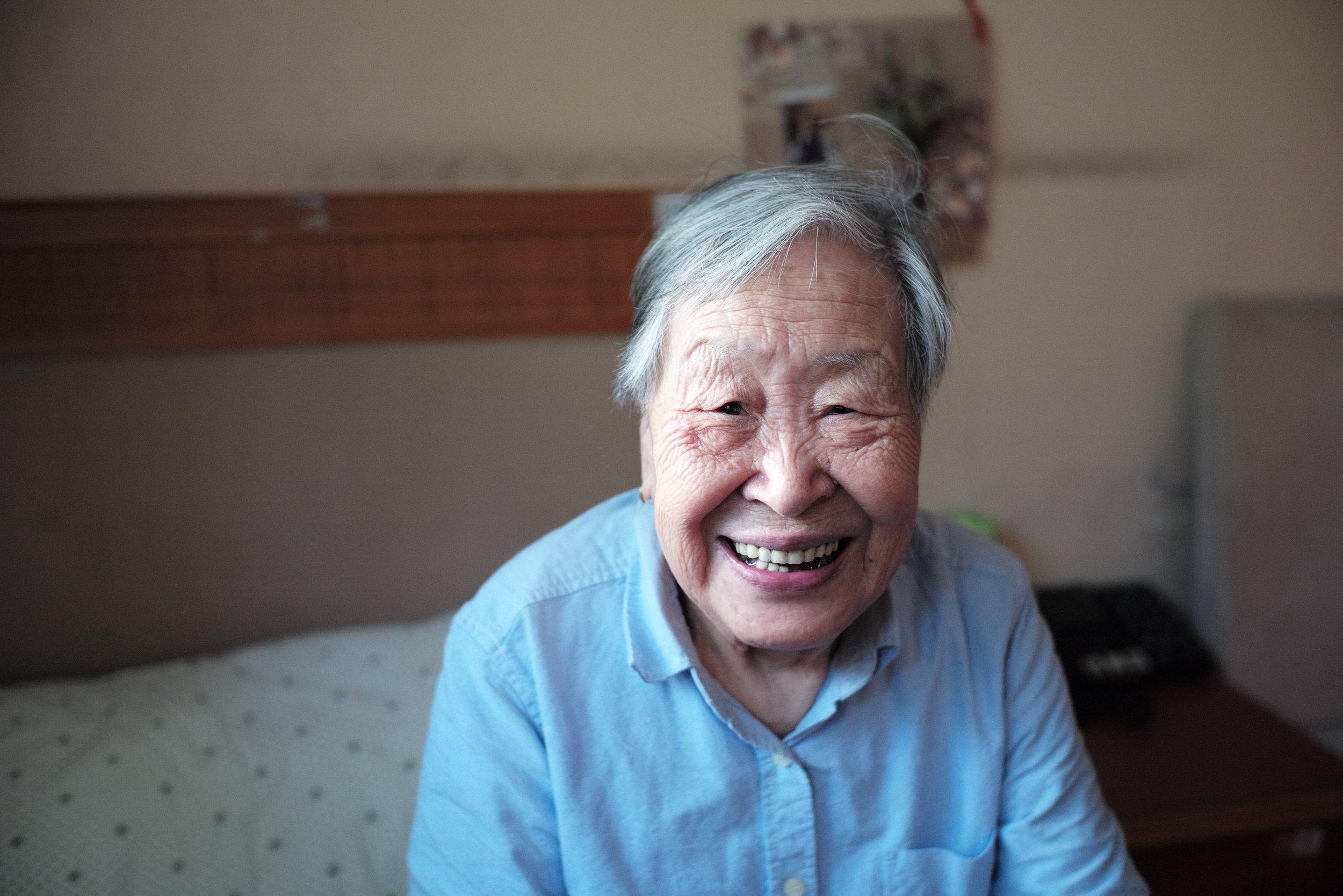 Elderly main in a nursing home room