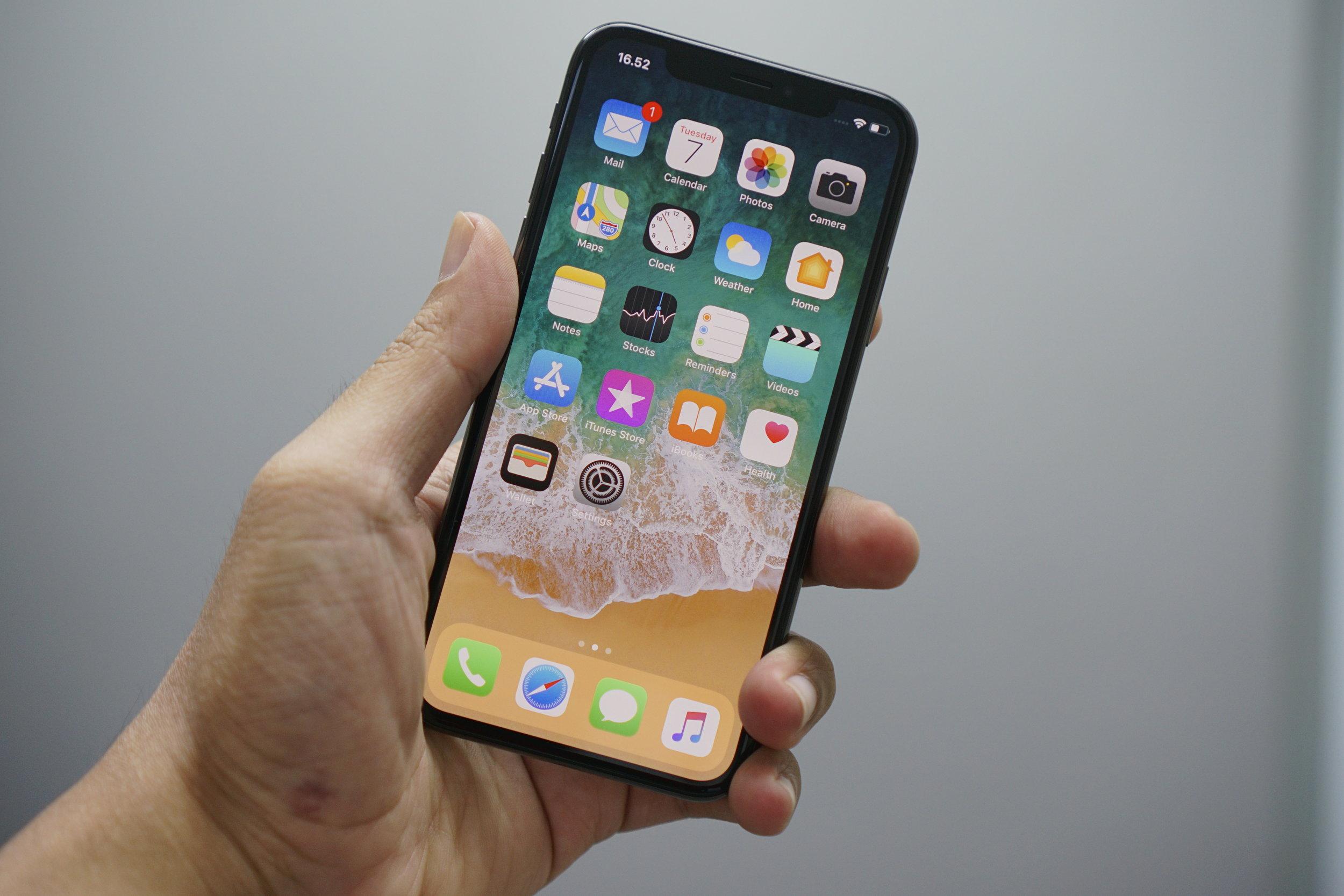 A man holding an Apple iPhone