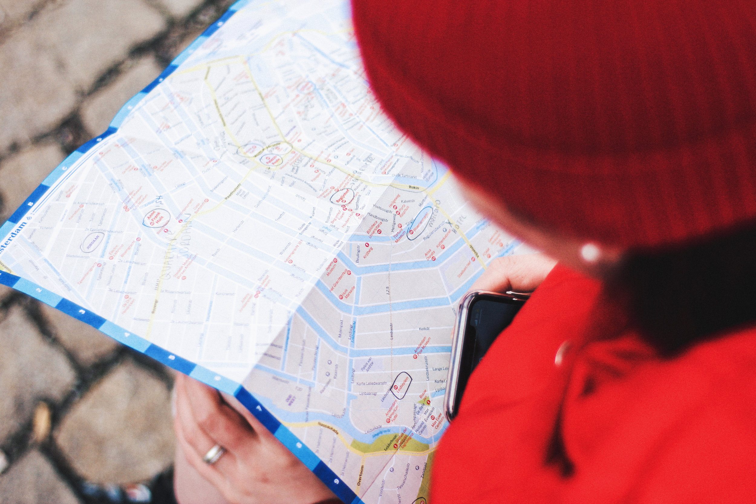 A woman looking at a street map
