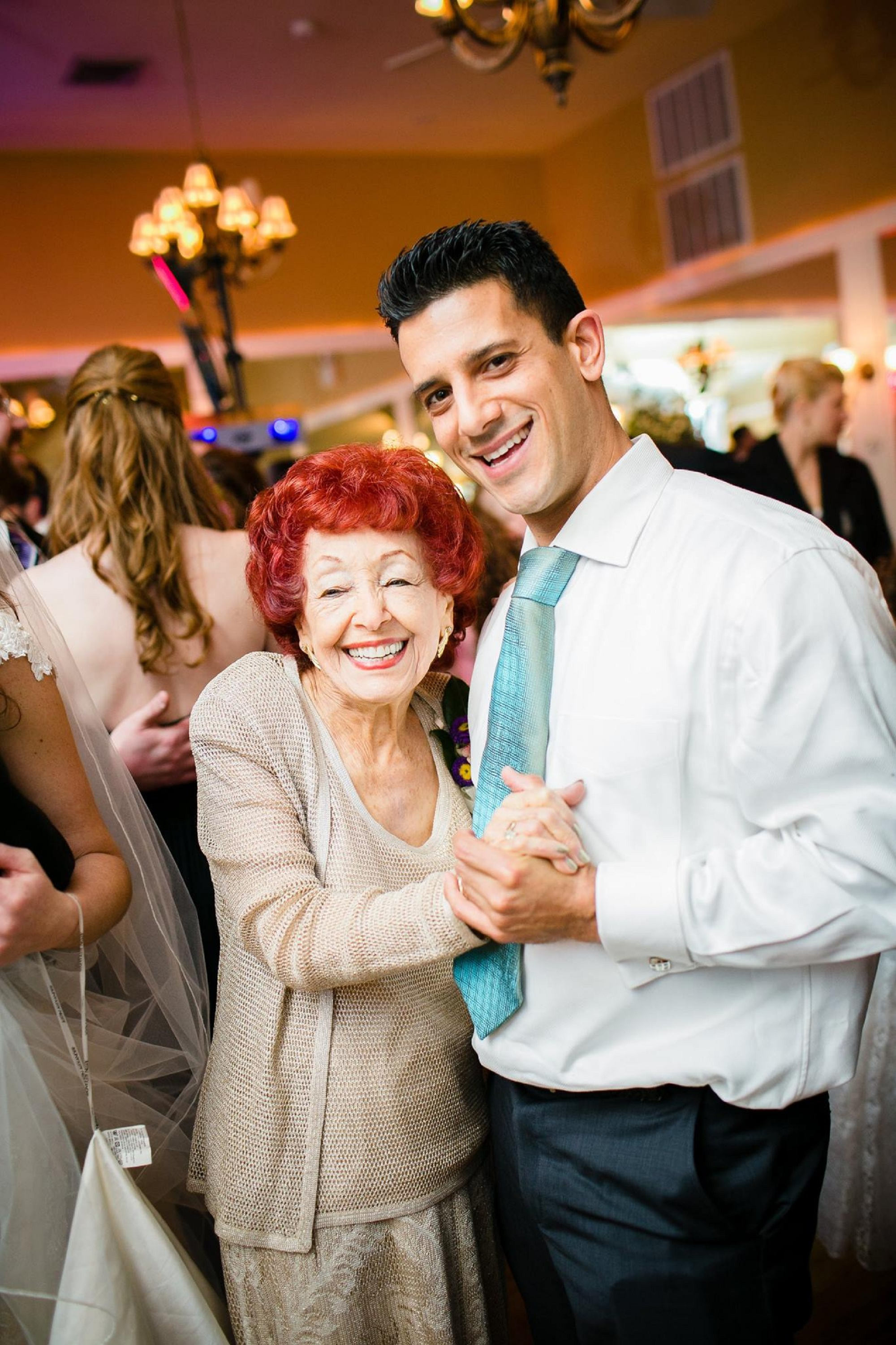 An older woman and younger man dancing at a wedding
