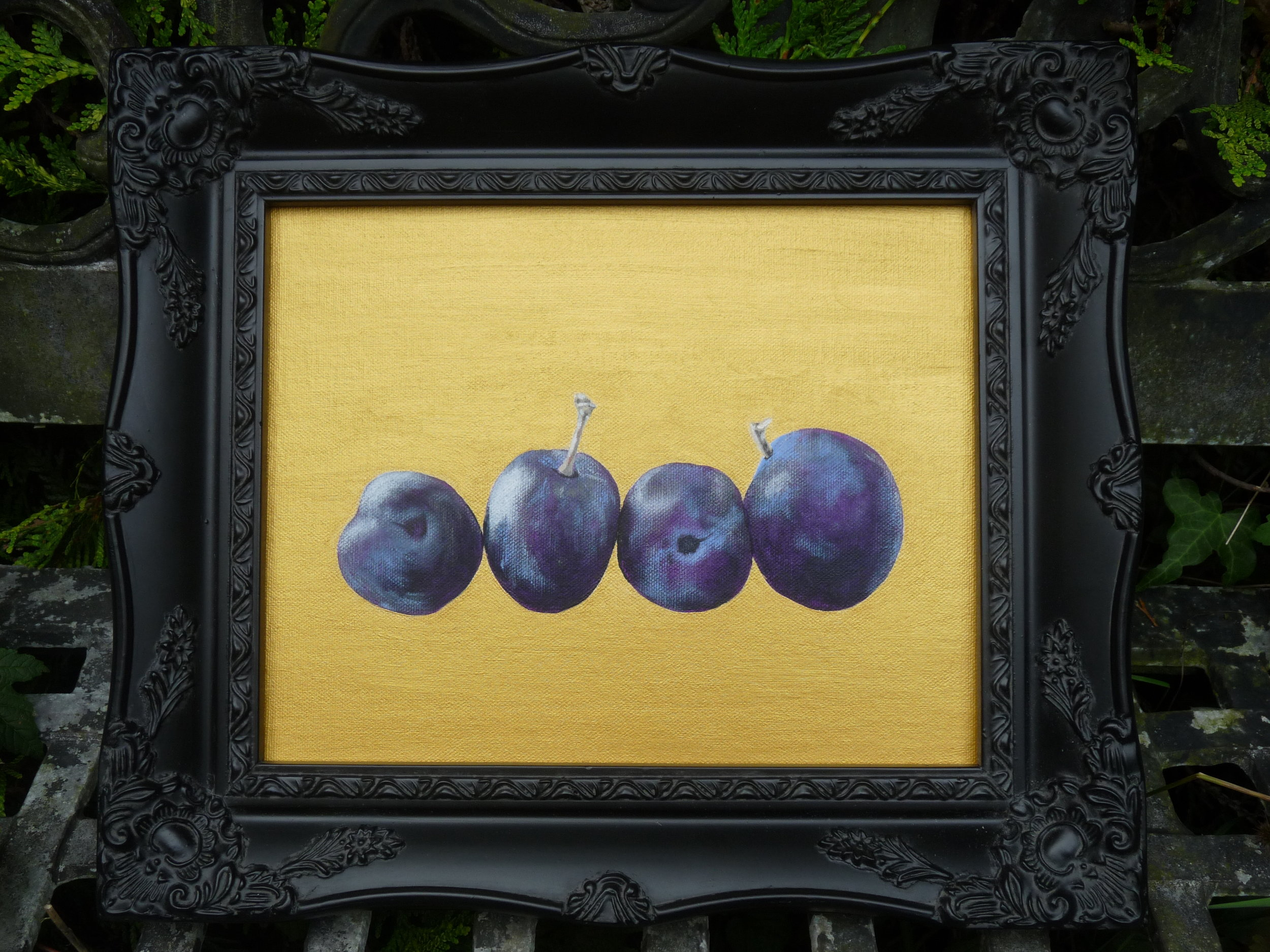 Plums on gold