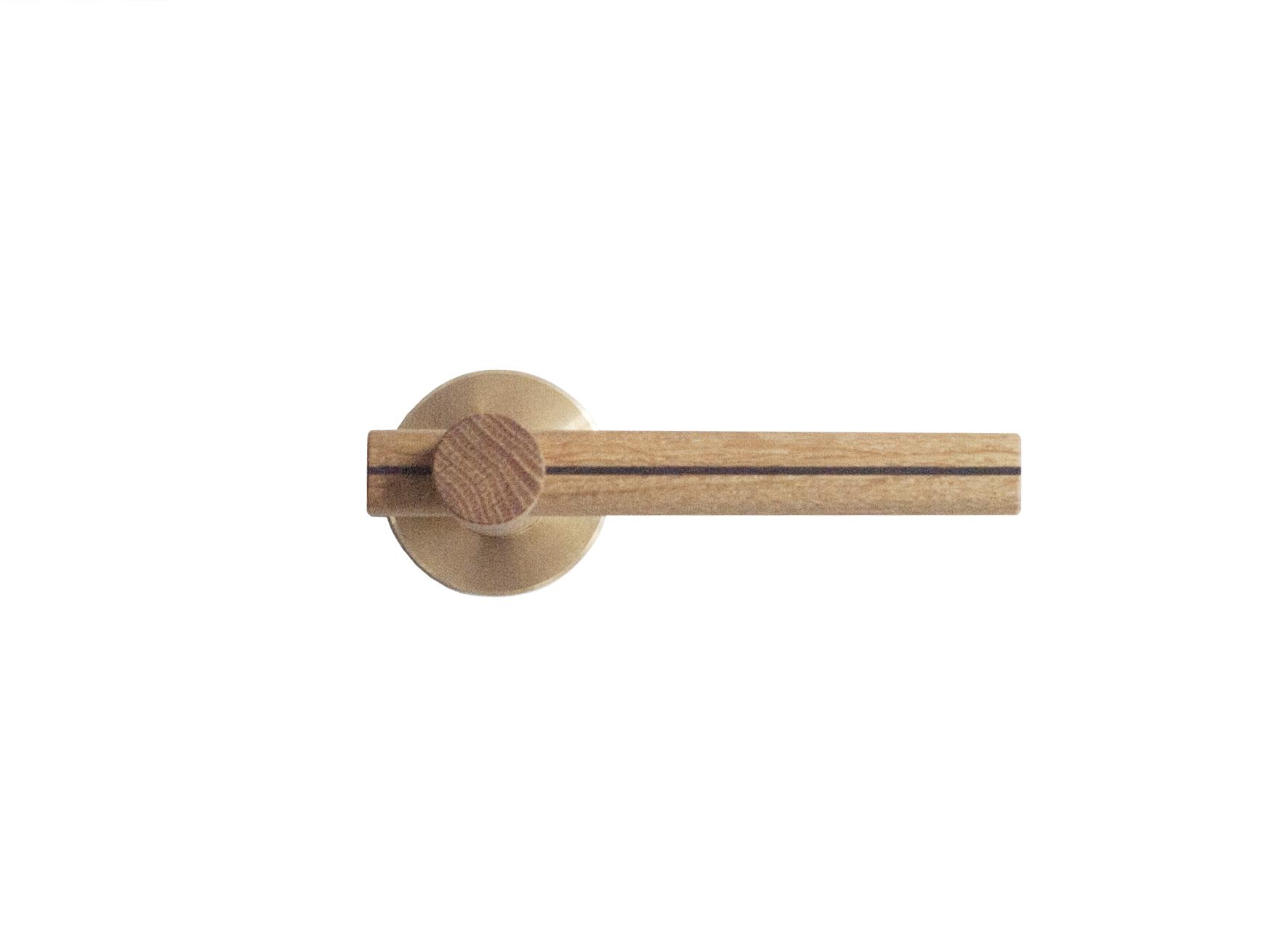 Door handle in oak and fumed oak treated with linseed oil.