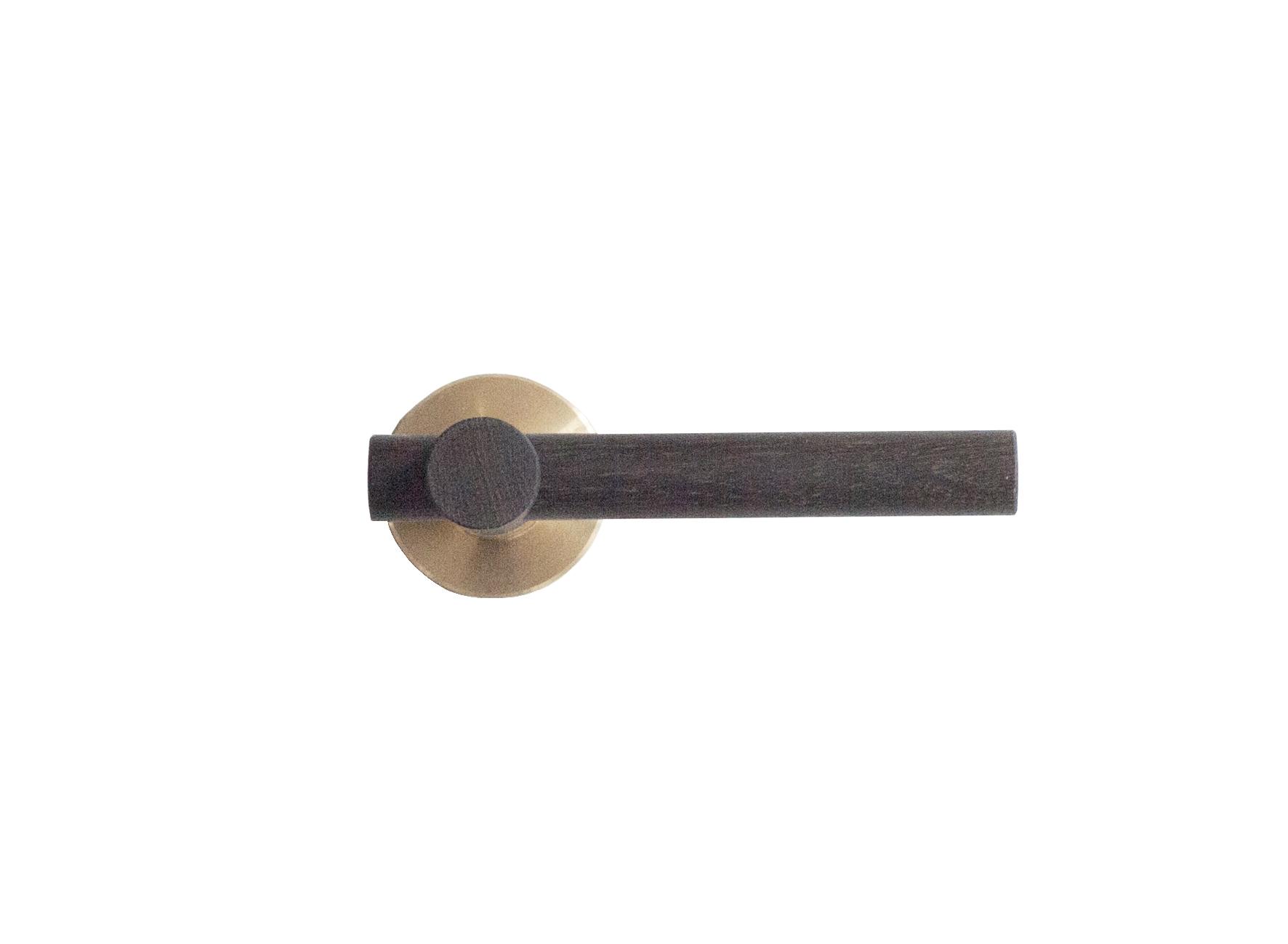 Door handle in fumed oak treated with linseed oil.