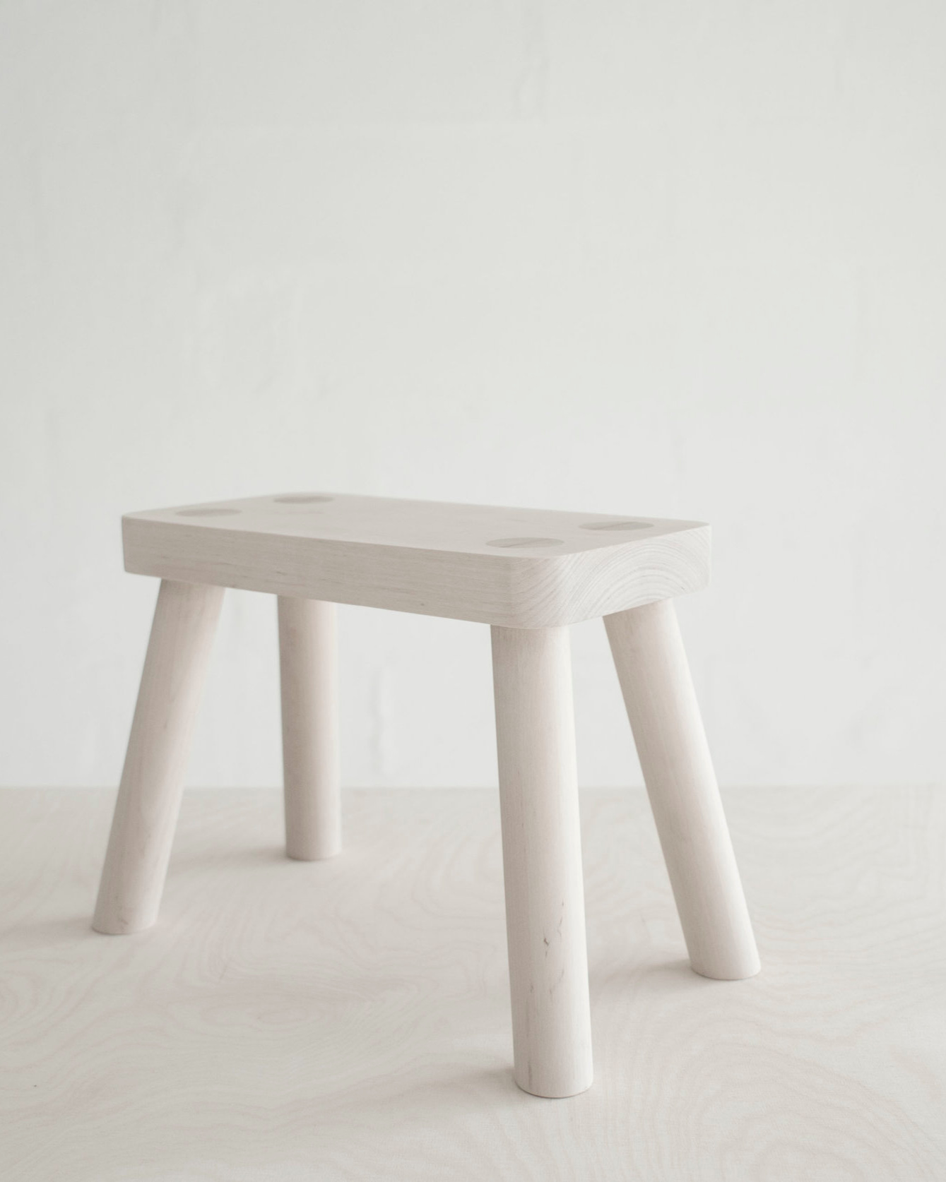 WEDGE STOOL - A classic stool with visible wedge joints.