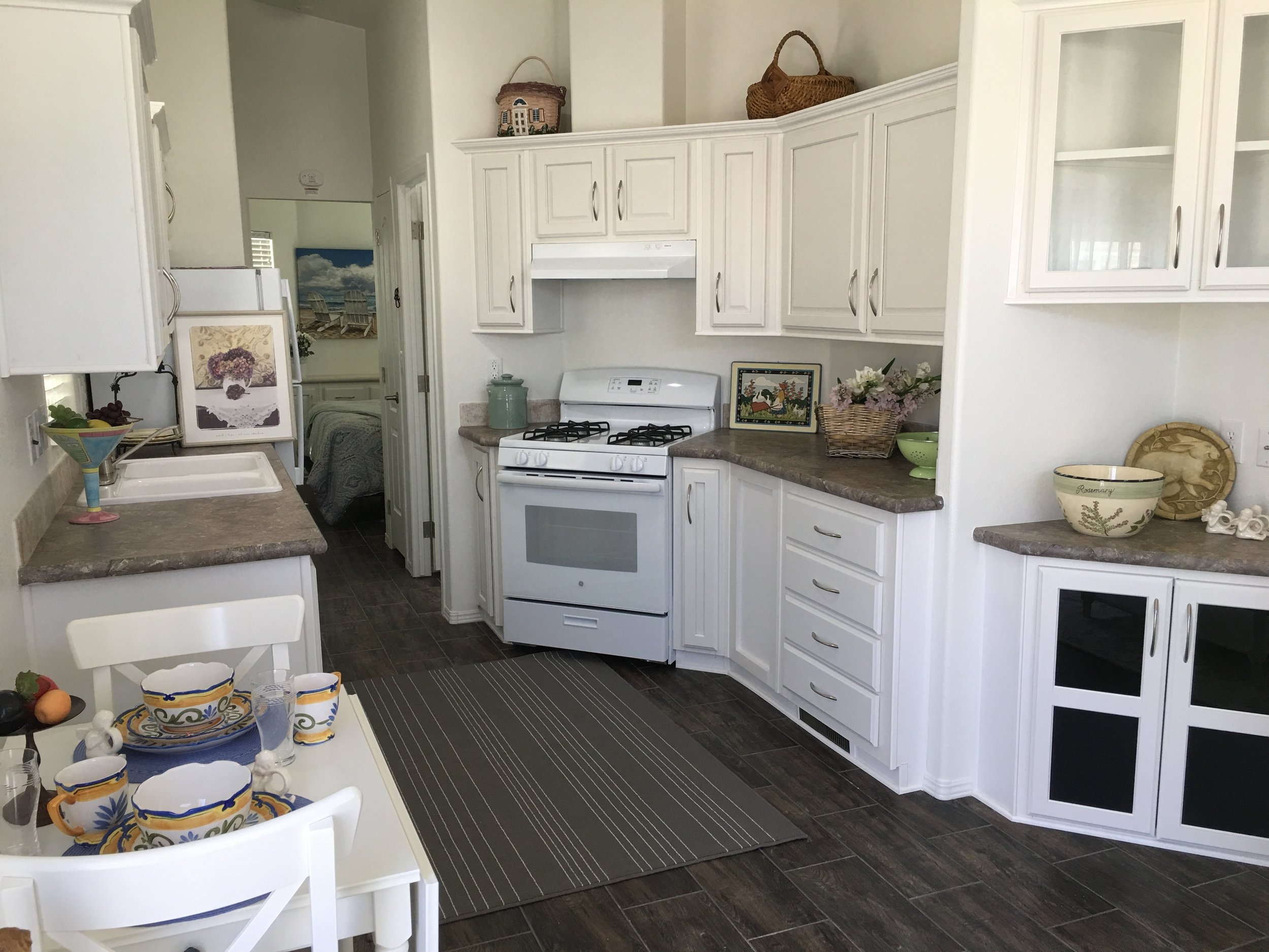 VACATION RENTAL FEATURES - Living, dining, and bedroom furnitureFlat screen TV and cableBed and bath linensFull-sized refrigeratorGas range / oven, microwave, toaster, coffee makerCooking and eating dishes and utinselsSupply of paper towels, toilet paper, trash bags, dish and hand soap.