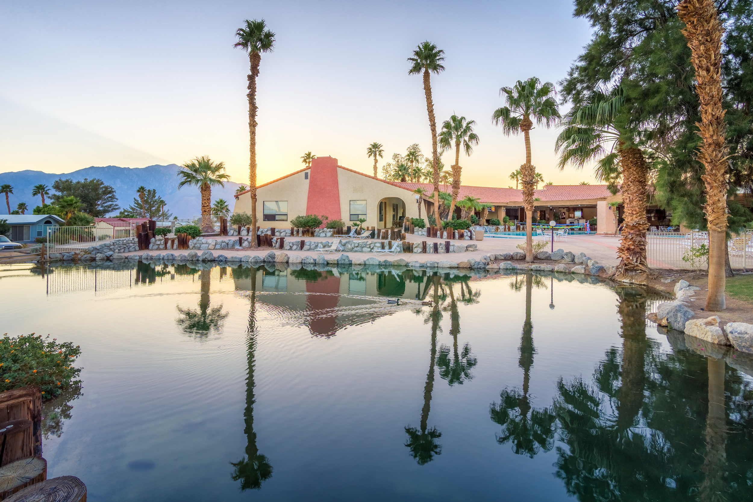 RESORT AMENITIES - Hot mineral pools, spas, and showersLarge clubhousePickleball and tennis courtsGolf course, driving range, and putting greenFitness roomDog parksLibraryGame roomLaundry facilities