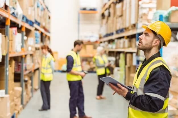 focused-warehouse-manager-writing-clipboard_13339-298859.jpg