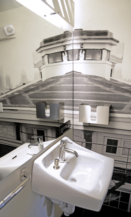 Site-specific artistic photo-wallpaper for Girard Brasserie's restroom, wrapping three of the walls. Julia photographed from the roof of the restaurant. The final image is a black and white interpretation of the surrounding cityscape. A mirror  hangs above the sink and toilet, reflecting the entire scene.
