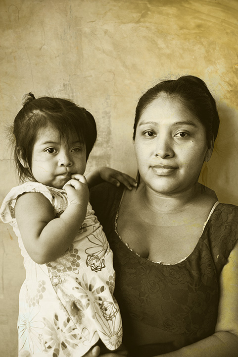 The jewelry-maker and her daughter.    Bonöre is a photography series centered on the work of an indegenous collective of women artisans in Bastimentos, Panama called the Ngäbe. Blaukopf worked with the women in 2017 and subsequently manipulated her images, applying layers of gold to create a multi-textured, evocative view of the women's lives.