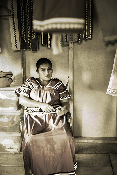 The Seamstress.    Bonöre is a photography series centered on the work of an indegenous collective of women artisans in Bastimentos, Panama called the Ngäbe. Blaukopf worked with the women in 2017 and subsequently manipulated her images, applying layers of gold to create a multi-textured, evocative view of the women's lives.