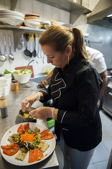 Cristina, chef and owner, working at  Madrago Café  in Lisbon, Portugal.
