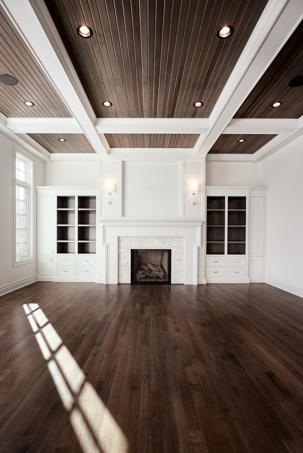 Crown moulding and beautiful matching fireplace with shelving surround