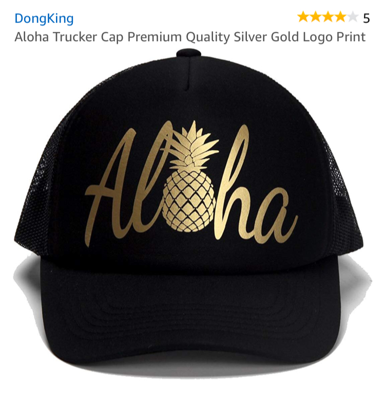 gold and black aloha hat. trending.