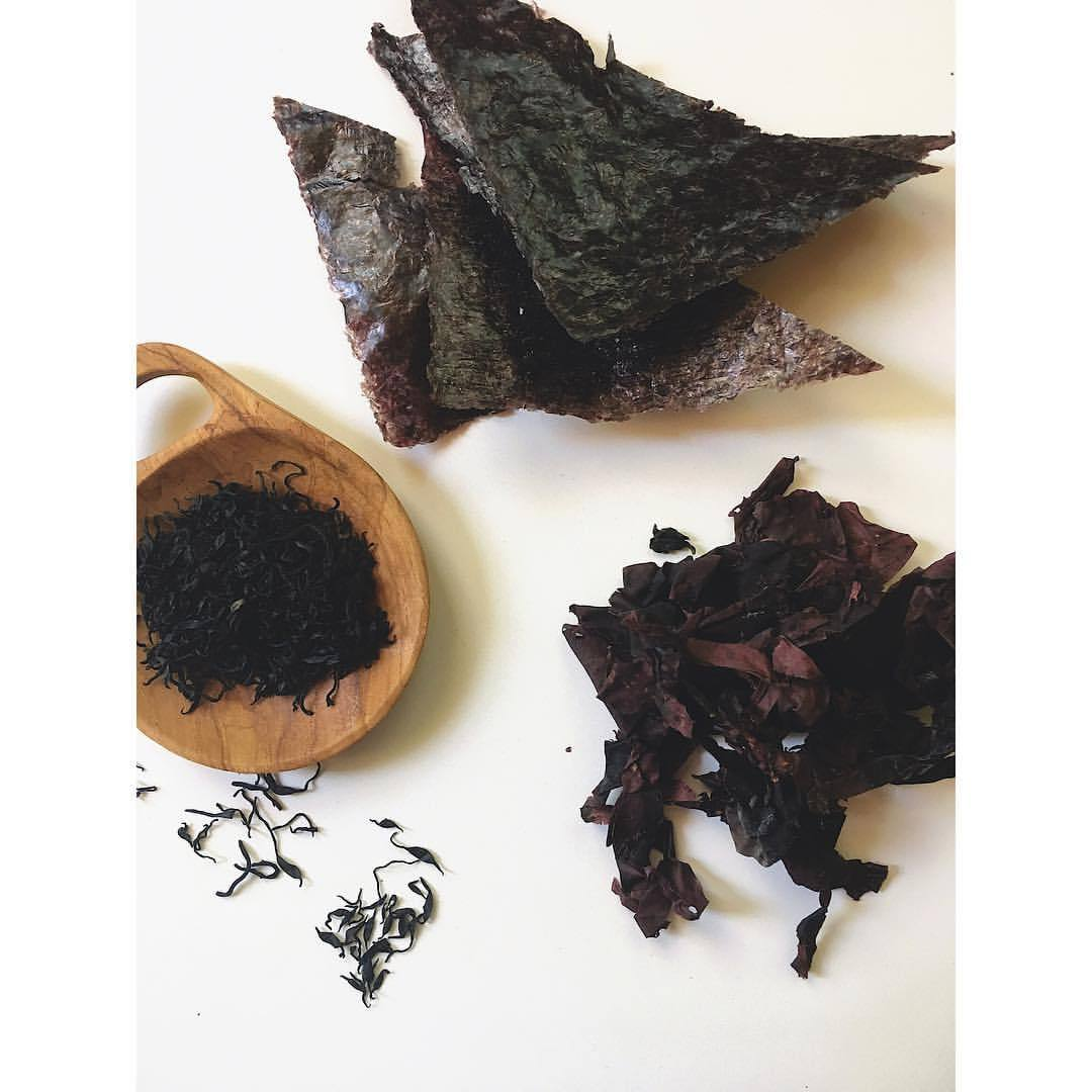 Seaweed is the ultimate YIN food. Born below water and out of salt and mineral comes this dark, edible plant rich with nutrients. I always learned a little cheat sheet to recall the powers of seaweeds. Hijiki = Calcium. Nori = protein. Dulse = Iron. If you are looking to supplement your diet in one of these areas, these foods are a wonderful way to start. They nourish the water element with their natural saltiness & help build and enrich the blood due to their high mineral content. Use them in salads, soups, wraps, or fry them dry for crispy sea-chips. They all have unique flavors and textures and can be a fun way to experiment in the kitchen. One of nature's true super-foods. 💙  .  .  .  #wellness #chinesemedicine #medicinekitchen #holistichealth #foodtherapy #foodismedicine #tcmnutrition #fiveelements #5elements #seaweed #hijiki #superfoods #eatclean #eatyourgreens #eattherainbow #waterelement #minerals #underthesea