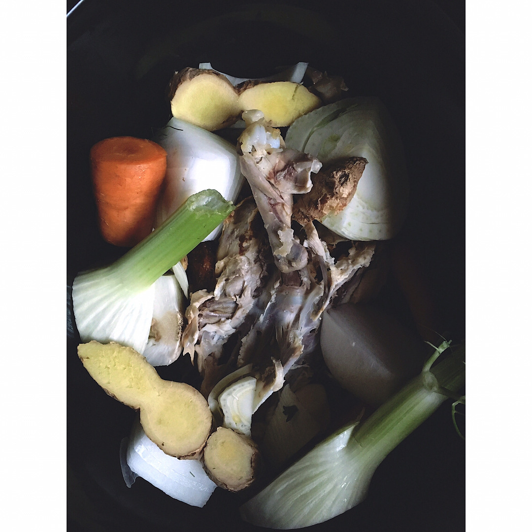 *Bone Broth* is incredibly mineral-rich and nourishing due in large part to the gelatin you will get out of it from the long-cooked bones. There is a large amount of research on the beneficial effects of gelatin. • It aids digestion and can be used successfully to treat a myriad of intestinal disorders like colitis & Crohn's. • It is useful in many chronic disorders like anemia and diabetes. • It's a wonderful aide in illness recovery and post partum care. • It can even help prevent and mitigate infectious diseases.   ***  This weekend we had chicken tacos and I used the carcass to make a chicken bone broth. I like using mostly aromatics with it so it doesn't come out too sweet - fennel, ginger, garlic, peppercorns. It's perfect in a mug for afternoon pick-me-ups, for soups, sauces or try it as a cleansing breakfast/lunch with steamed veggies inside.