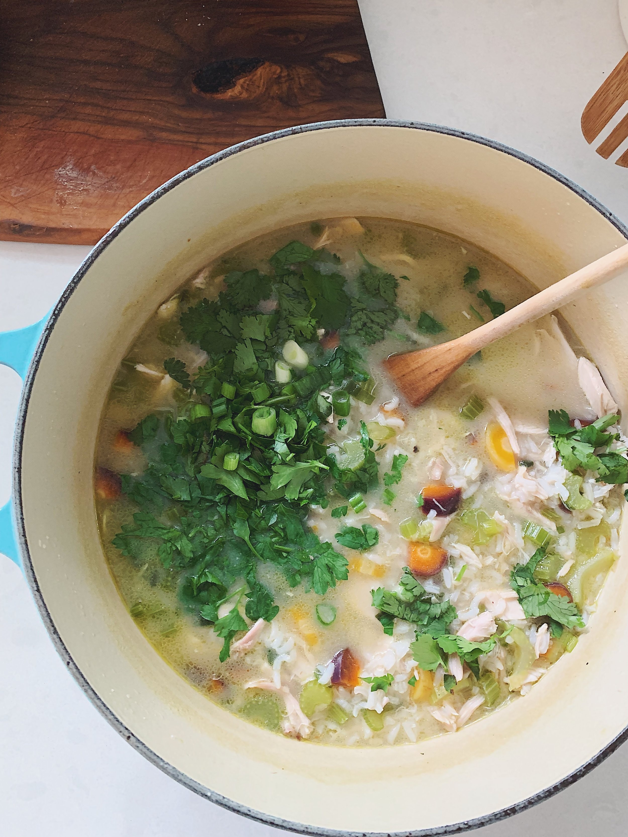 green chicken soup with rainbow carrots