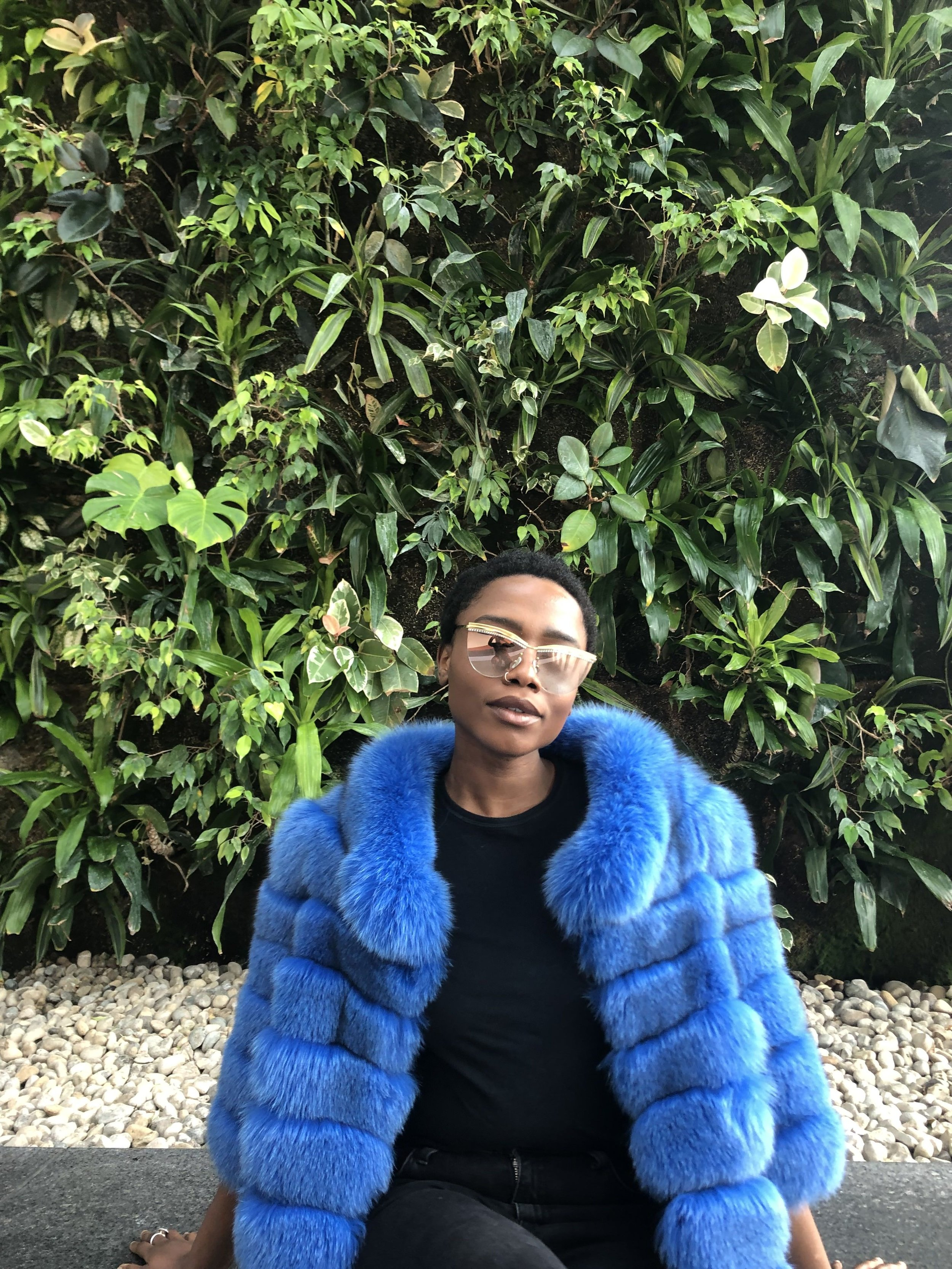Model Chidera Sunny wearing Sunglasses from World Eyewear and wearing HSG Fur