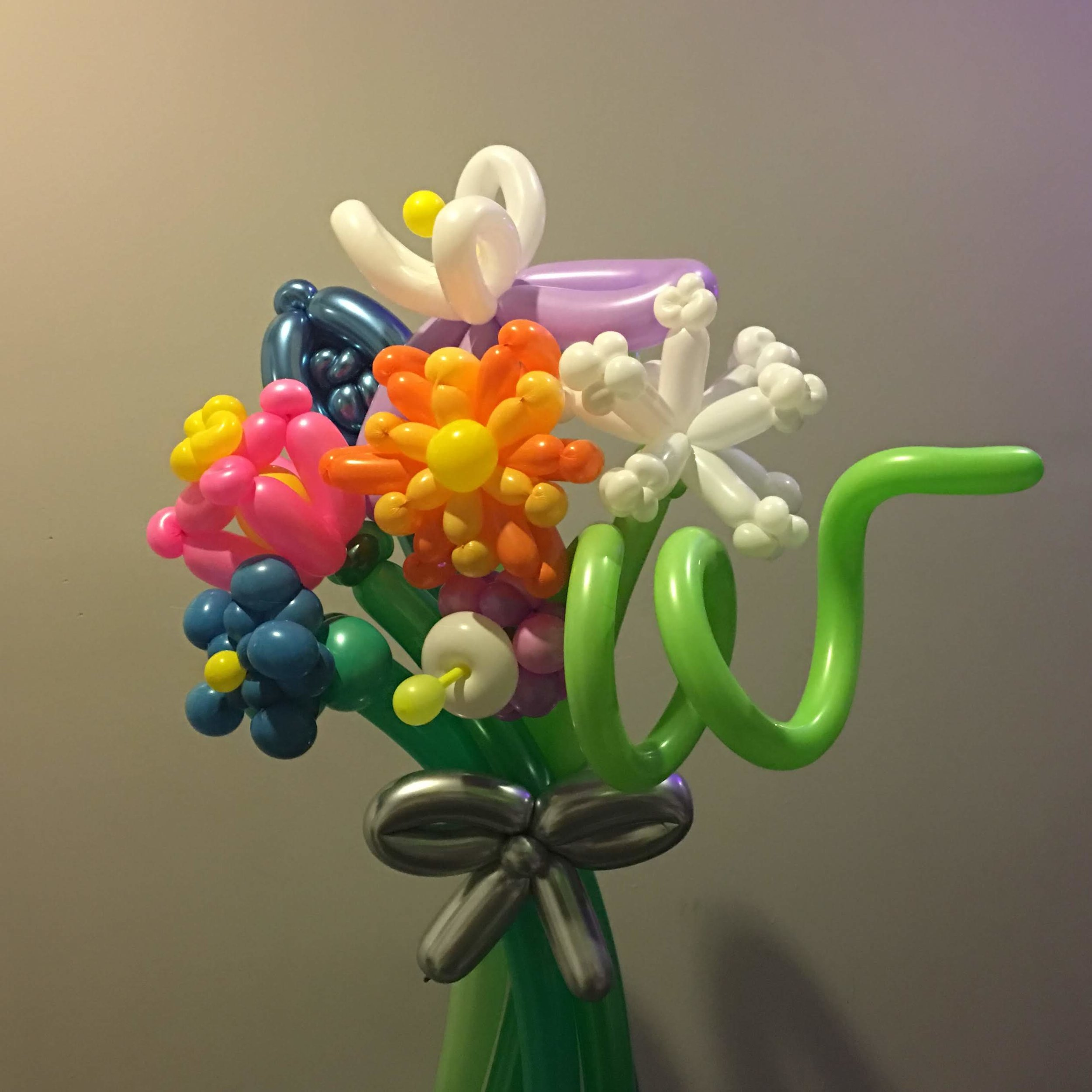 Bouquet. Whimsical in vibrant palate in loose flowers with bow and extra awesome.jpg