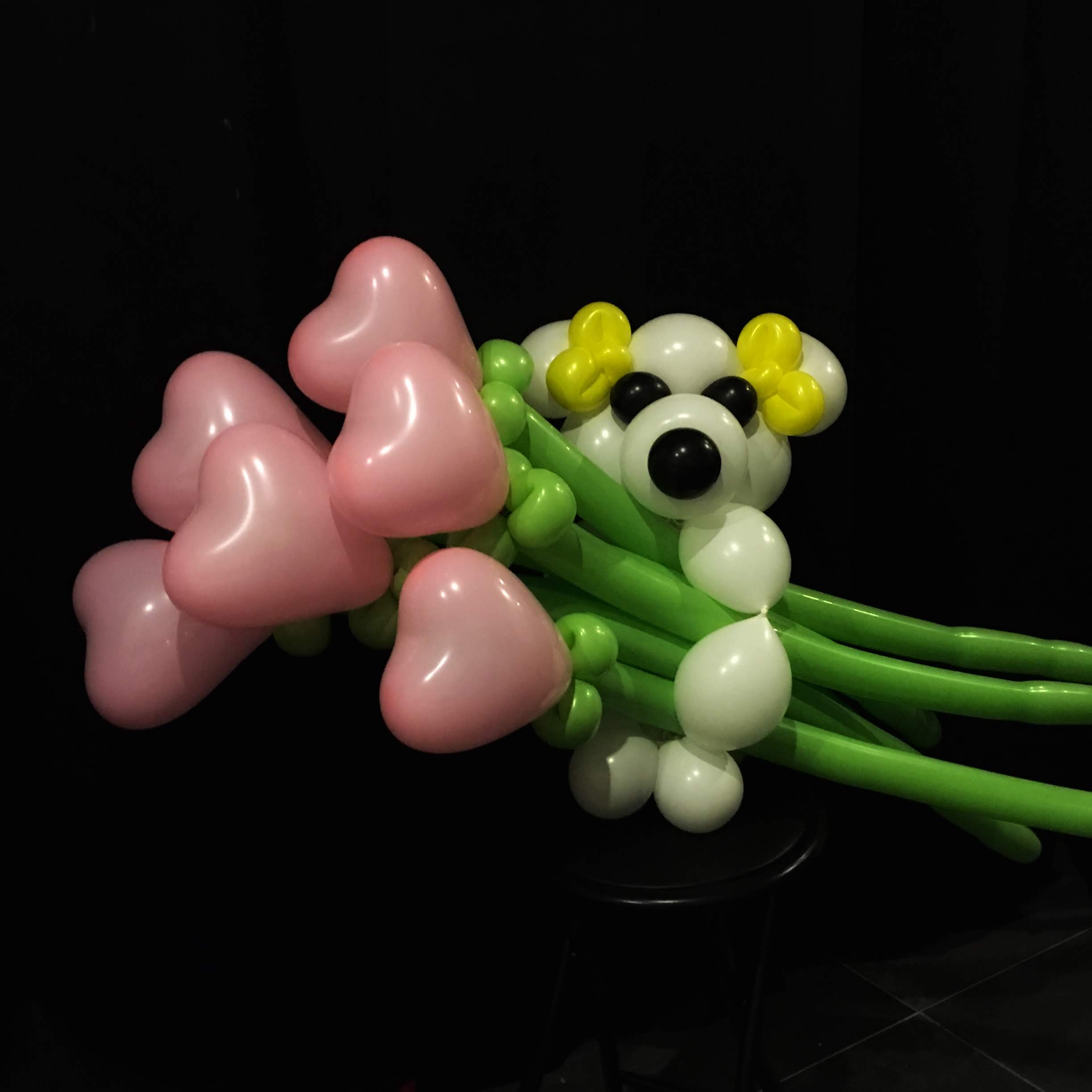 Bouquet. Heart bouquet with loose flowers and bear hug base.jpg