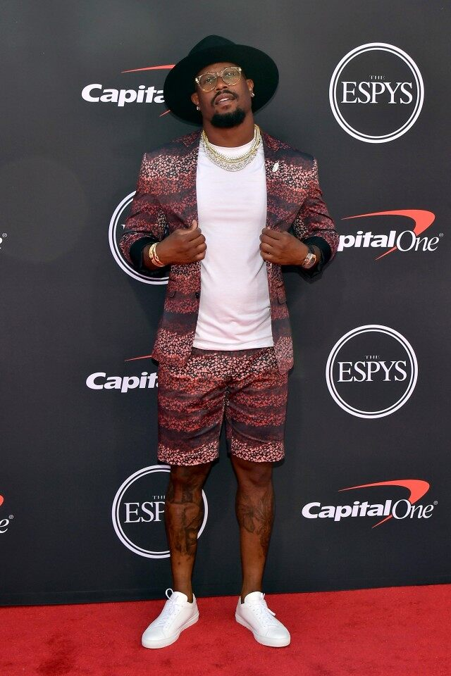 Broncos linebacker Von Miller in a ombréd pattern short with matching blazer from  Chandra Ferrer .  Jason of Beverly Hills  chains and  Gladys Tamez  hat.