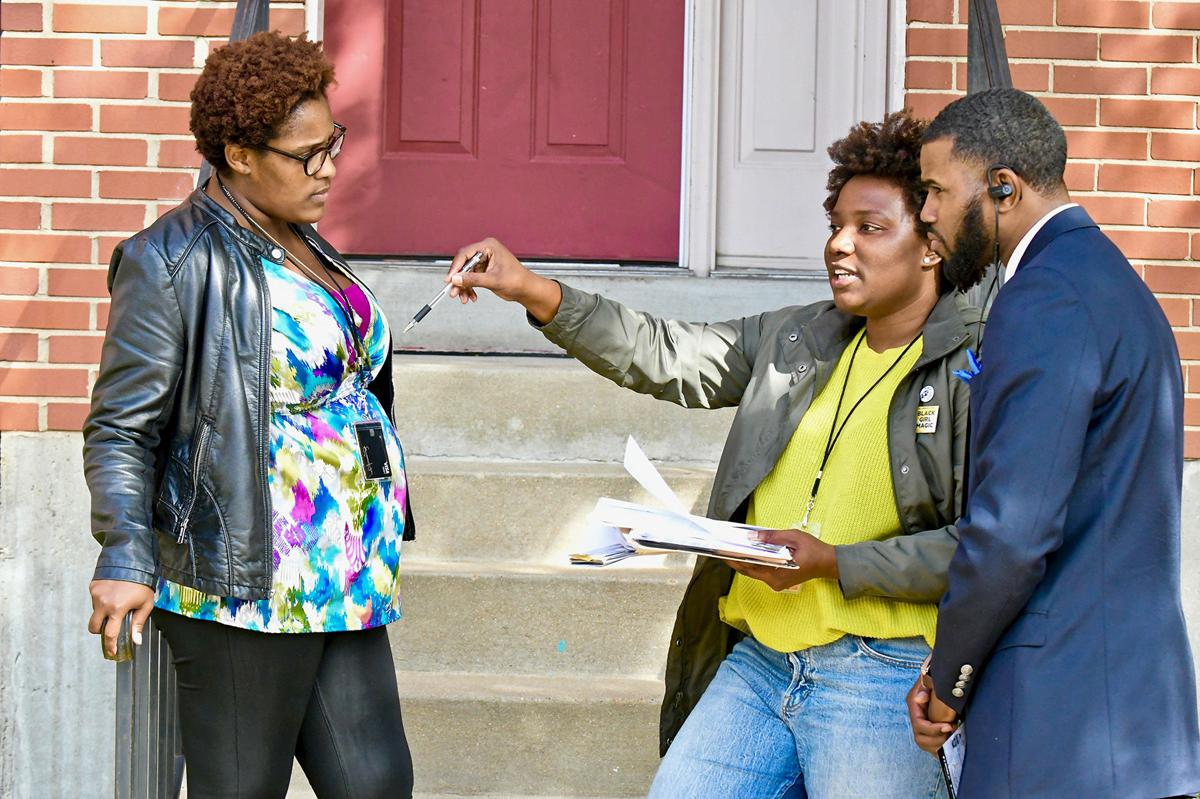 Elise Hawkins and Monti Hill spoke with Jerome Harris on Tuesday, October 30 as they canvassed the 3700 block of North Market Street to help get out the vote for the November 6 general election.  Photo by Wiley Price / St. Louis American