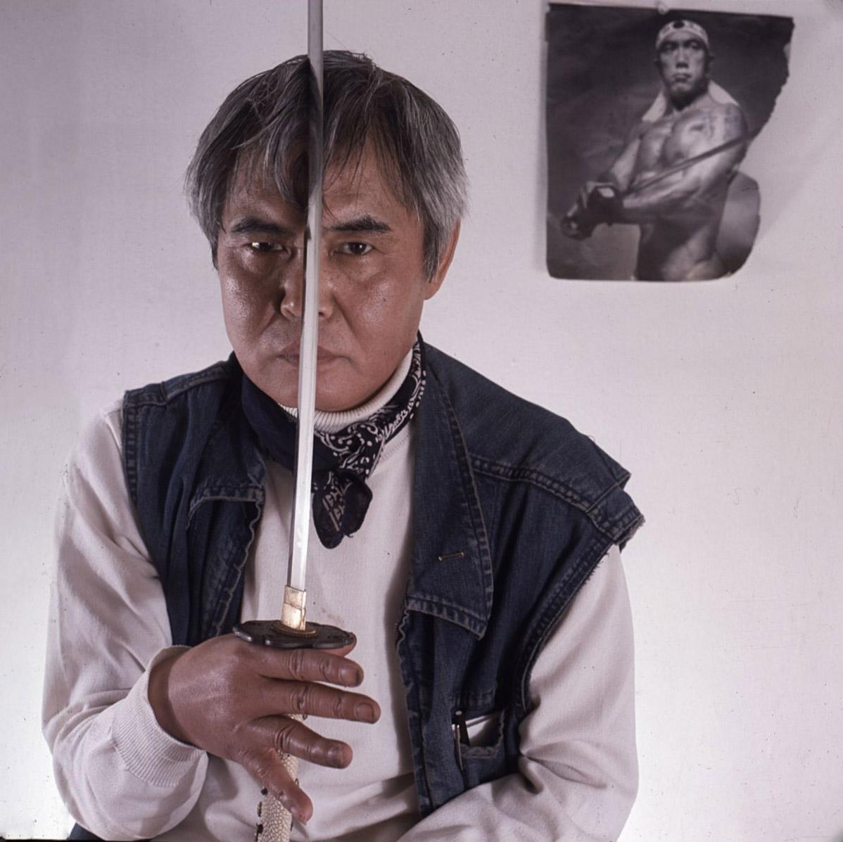 Kanemitsu posing with a sword, circa 1972.