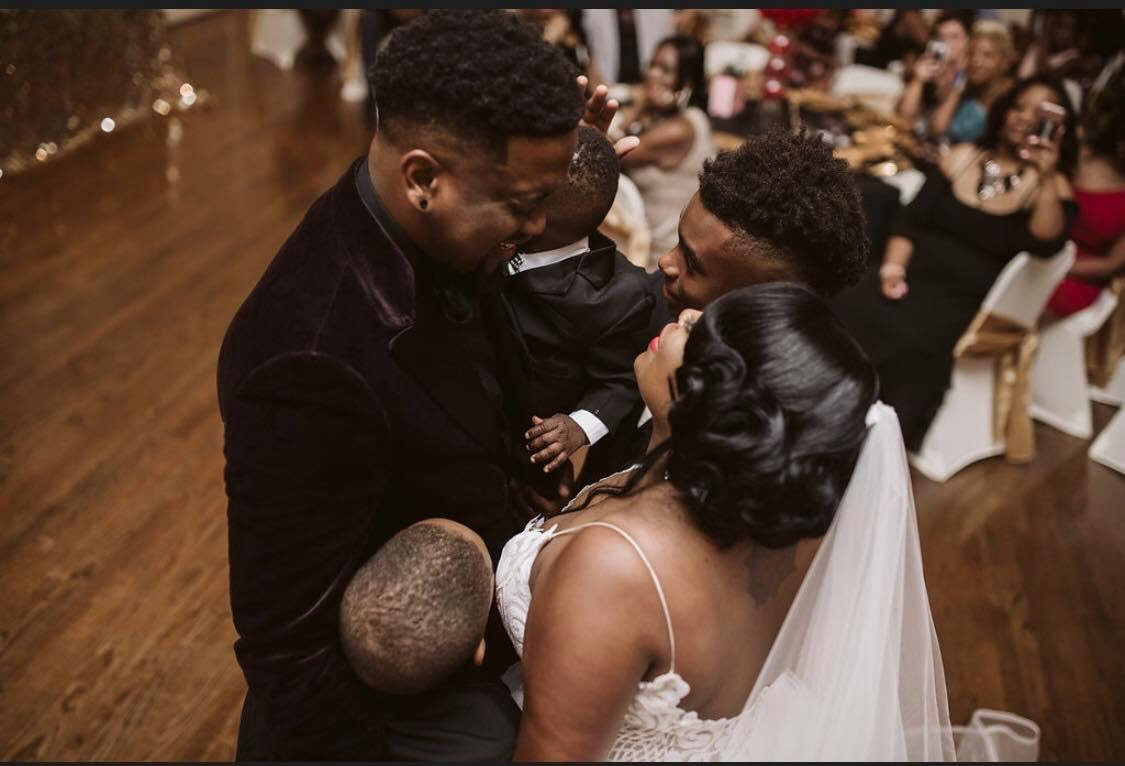Donte, his wife, Lakeisha, and their three boys, sharing an emotional moment on their wedding day!
