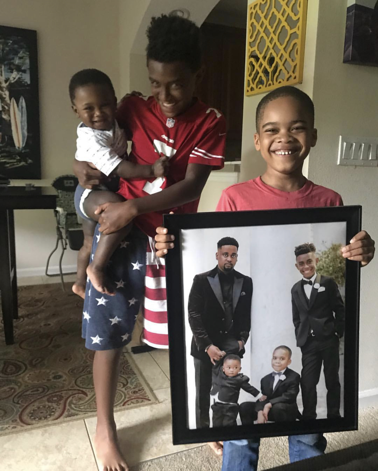 The Palmers' three boys gifting Donte with a fathers day gift!