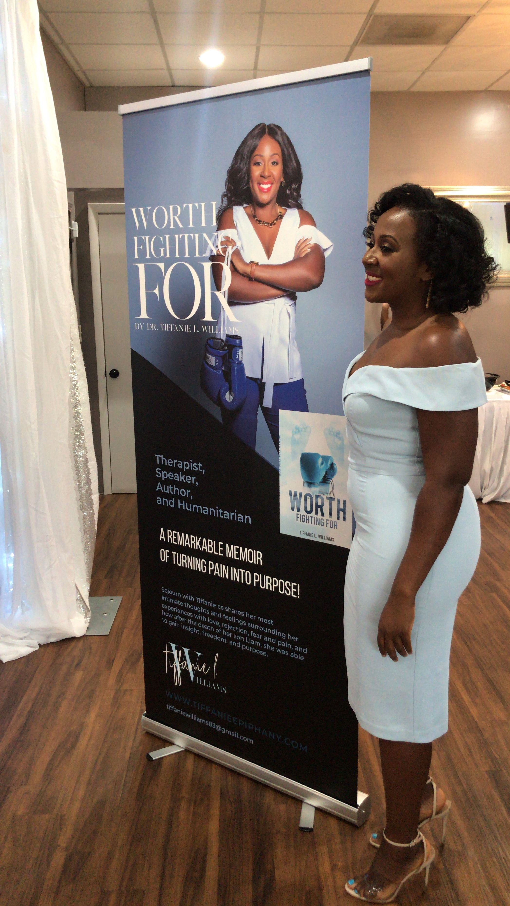 The beautiful author taking photos in front of her banner!