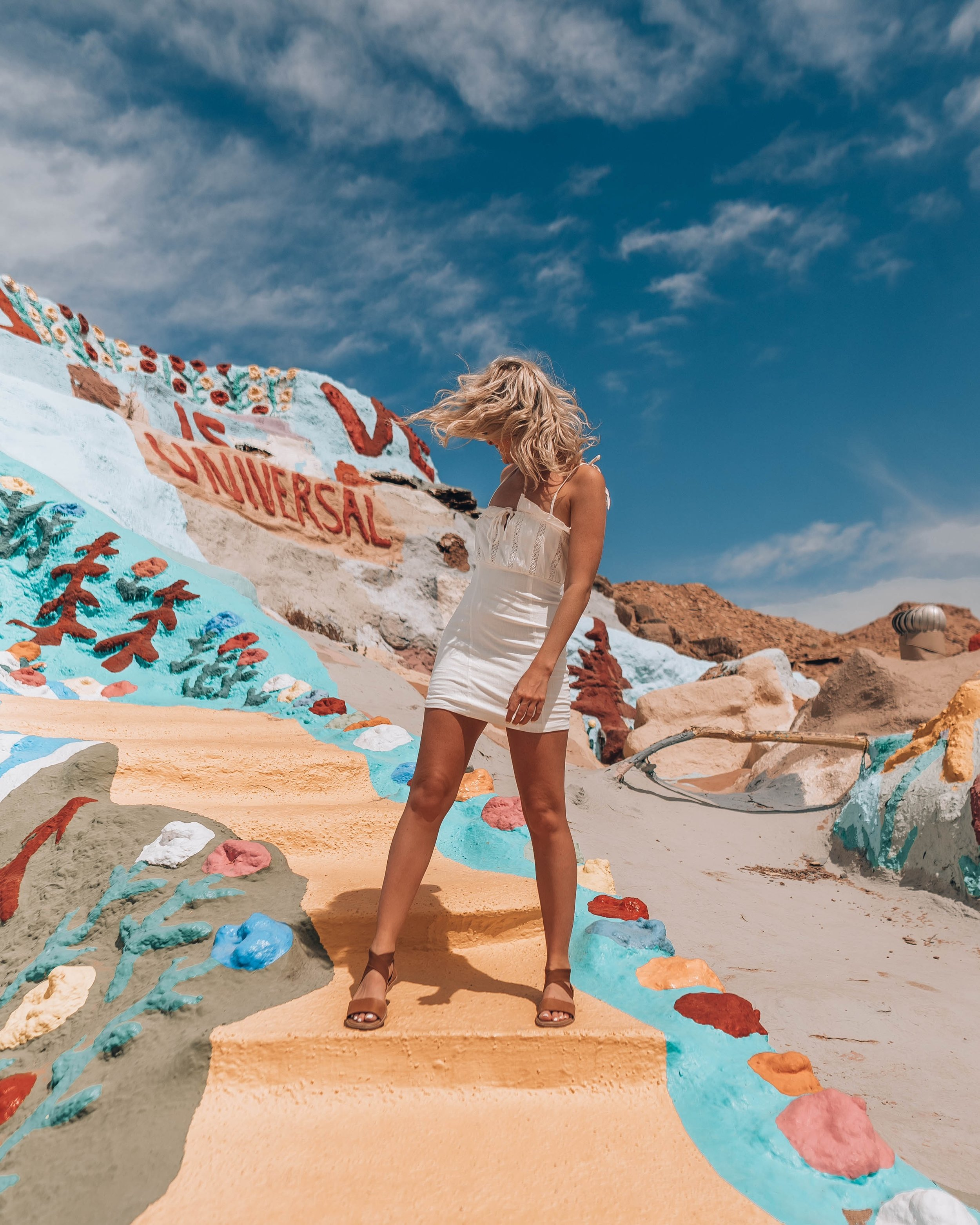 Salvation Mountain - A man-made mountain covered in half a million gallons of latex paint, definitely a one-of-a-kind sight 28 years in the making! Salvation Mountain is about an hour and a half outside of Palm Springs, the best way to get there would be by car, we rented a car during our California trip. Salvation Mountain was created by the late Leonard Knight, several religious words + sayings and messages of love cover the mountain. In addition to that, there are so many beautiful and vibrant colorful scenes that are literally picture perfect for photos.The address: 603 Beal Rd Niland, CA 92257