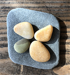 About the artist: Maggie Bodkin is a stone artist and beach walker who lives in Stow, MA.