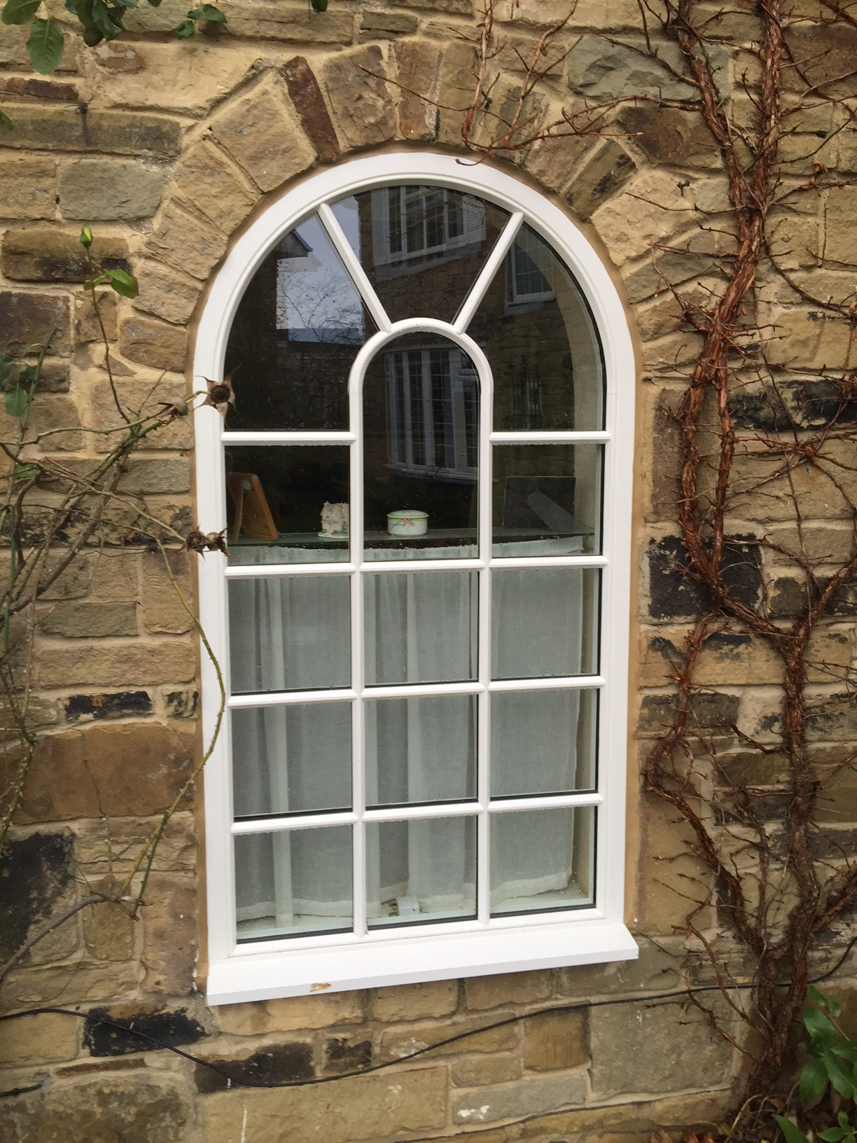 Timber Arched Window.JPG