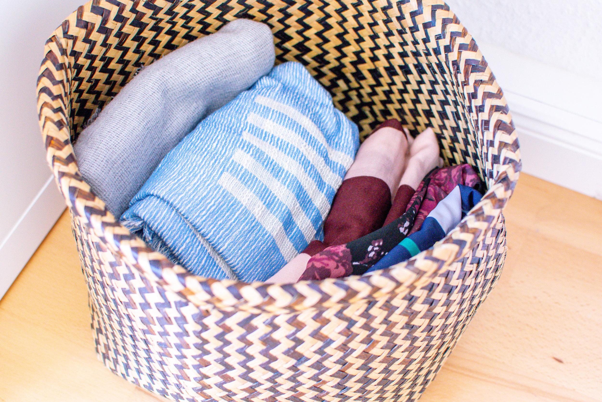 capsule wardrobe accessoires scarves in a storage basket