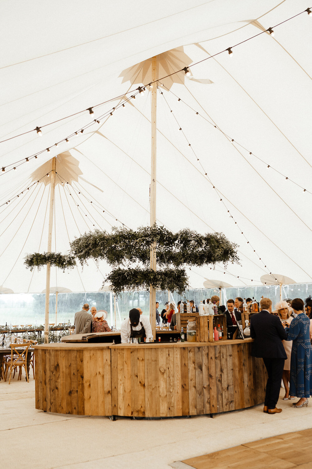 21_India-Sean-PapaKåta-Sperry-Tent-Wedding-Caitlin-Jones-Photography-Oak-Circular-Bar.jpg