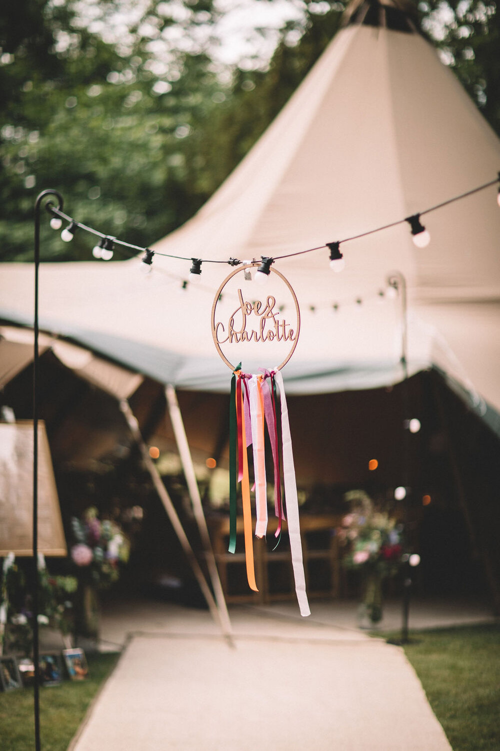 01_Charlotte-Joe-PapaKåta-Tipi-Tent-Wedding-North-Yorkshire-Lumiere-Photography-Tipi-Tent-with-Festoon-Walkway.jpg