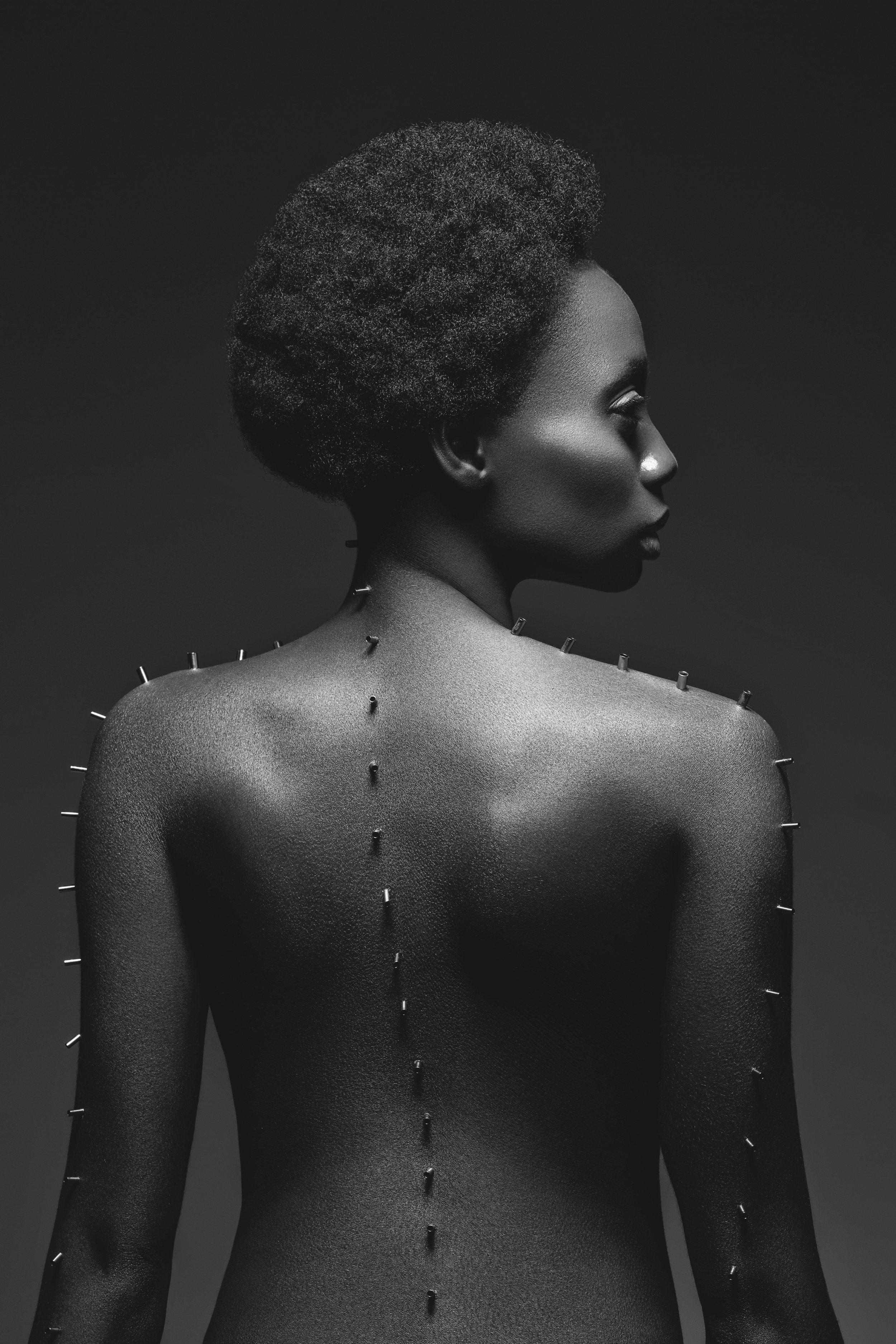 beautiful-black-girl-with-metal-pins-Z5BHVL8.jpg