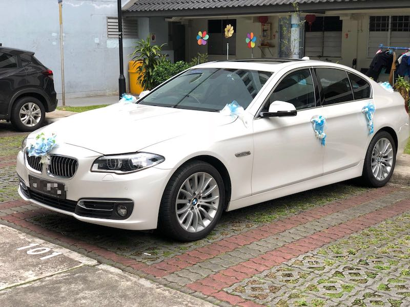 bmw with small wedding decor