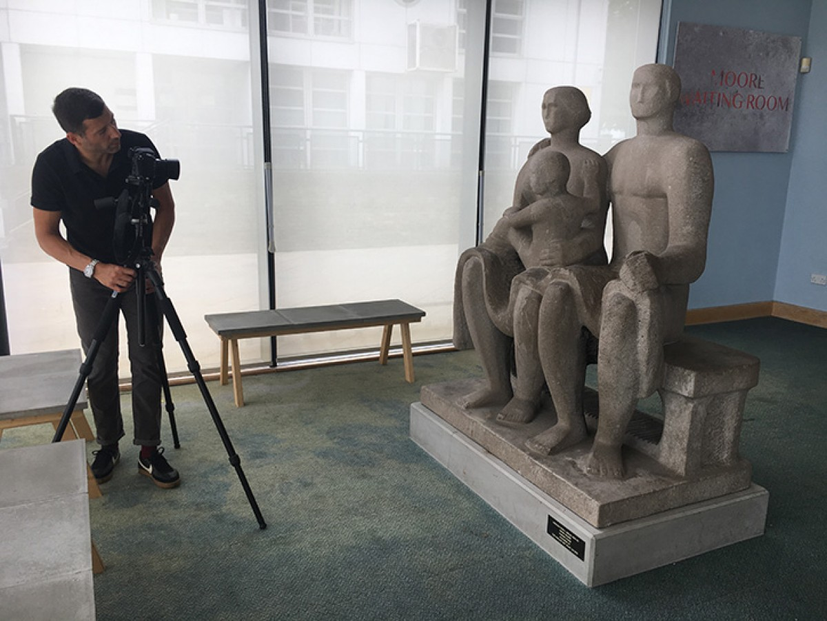 Jaron James photographing Henry Moore's 'Harlow Family Group'. Photo credit: Art UK