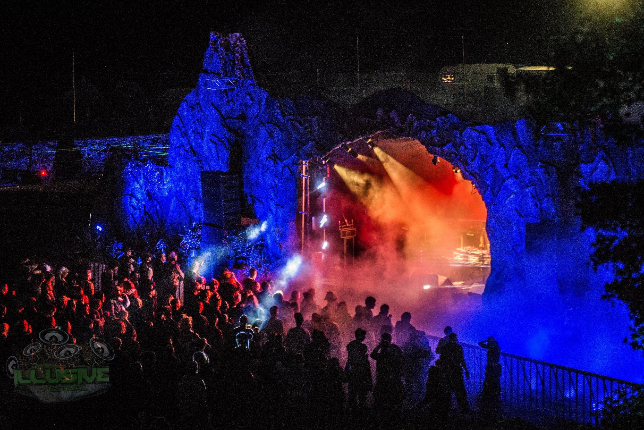 Blue lit mountain, festival stage.