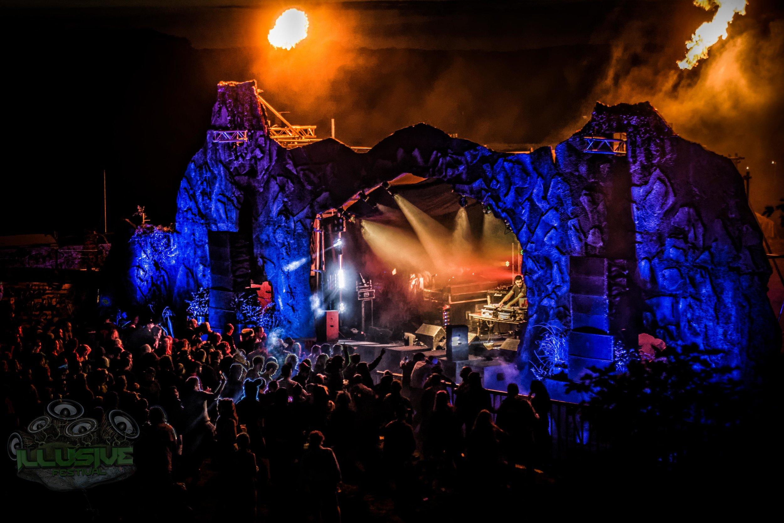 Mountain stage with orange backlit DJ.