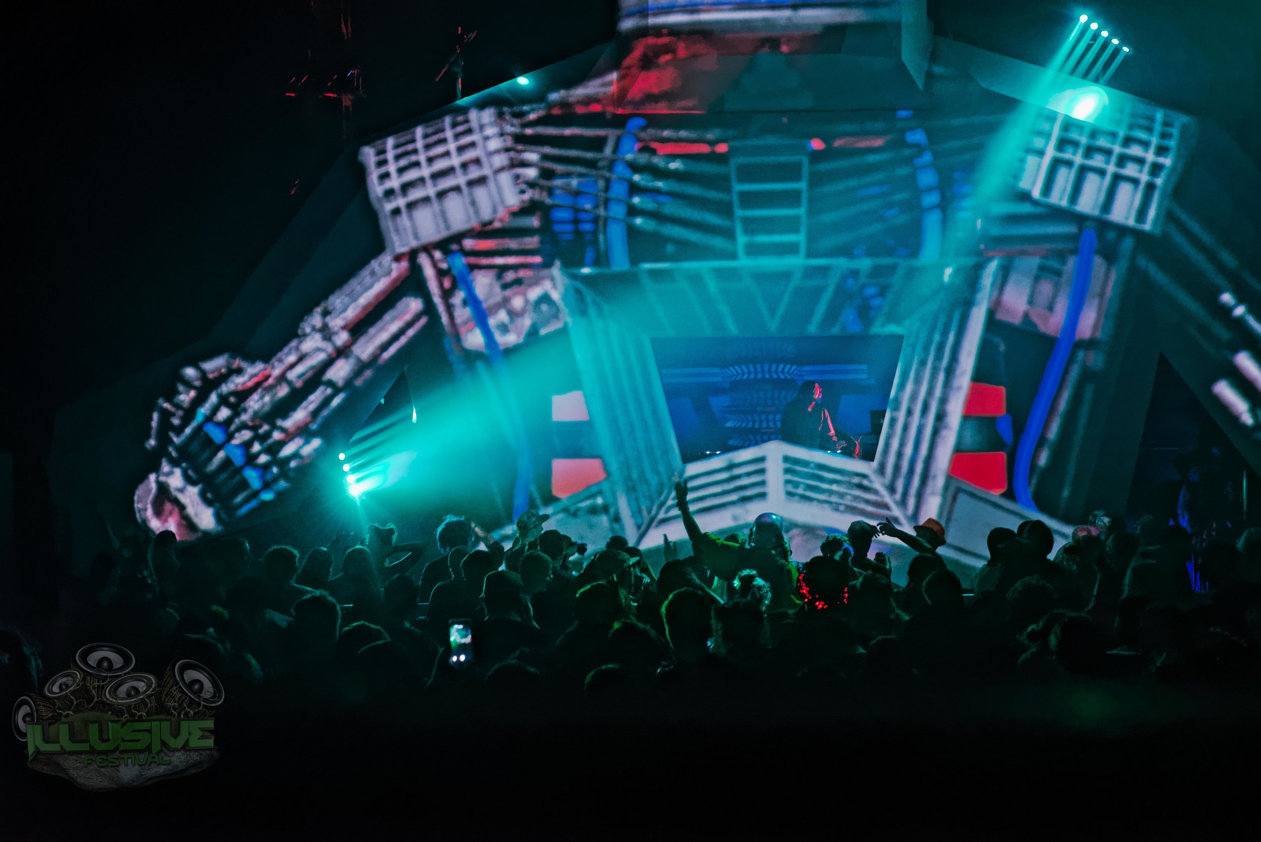Robot festival stage lit in blue.