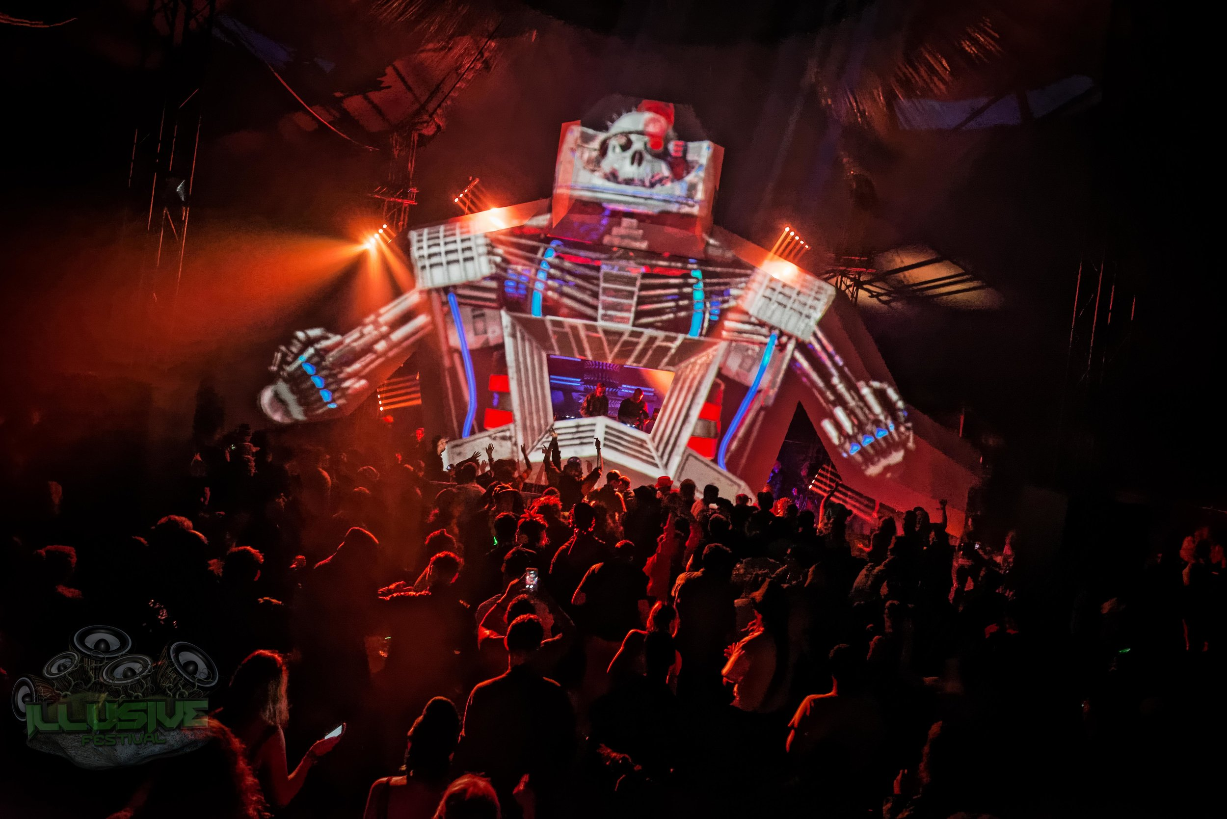 robot festival stage Lit in red.