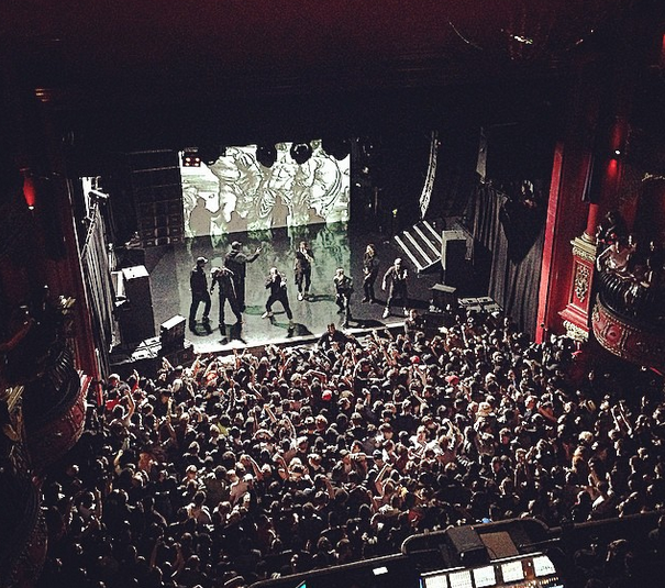 Kanye west on stage at koko with crew.
