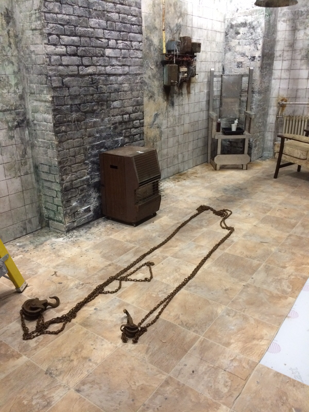 Rusted chains on the floor of horror room.
