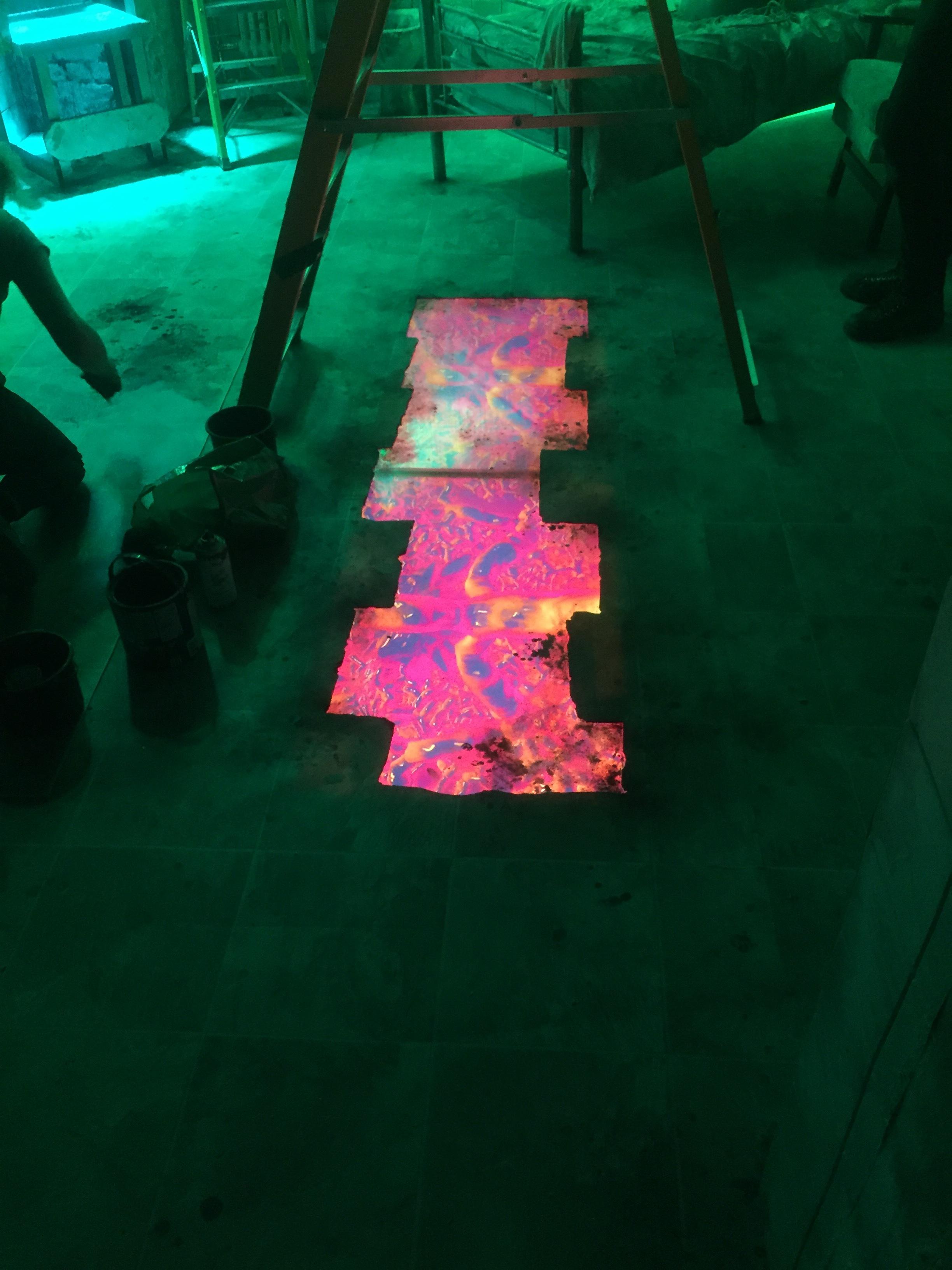 Lava floor in green lit room.