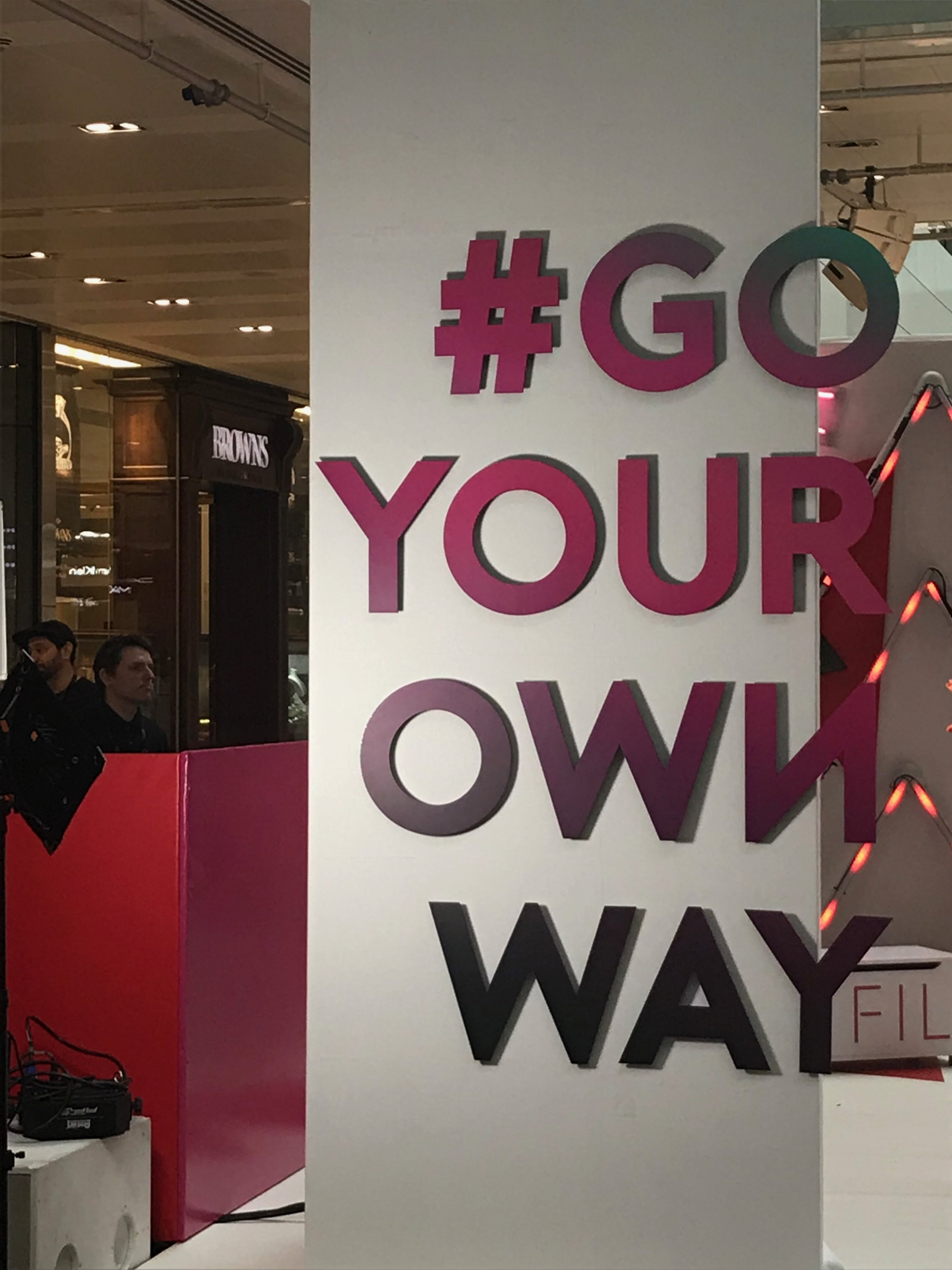 Pink GO your own way sign.
