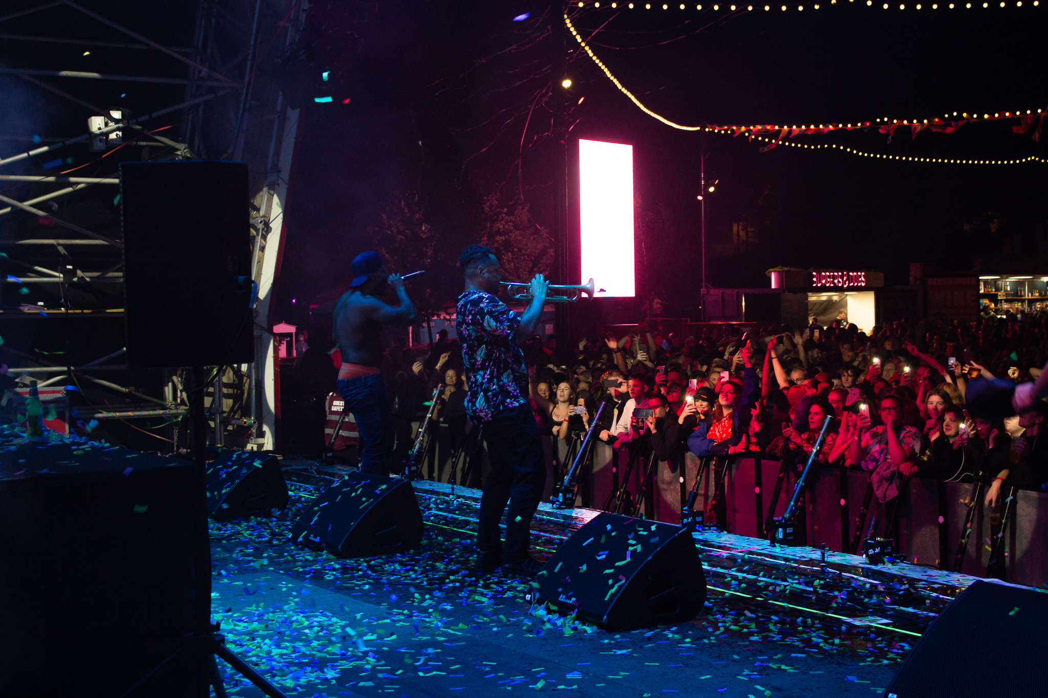 man playing sax in confetti